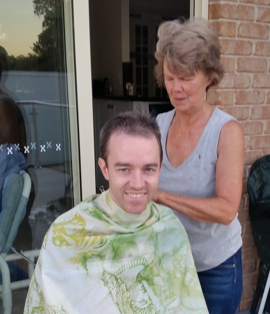 Pedr getting his hair cut by his mum.