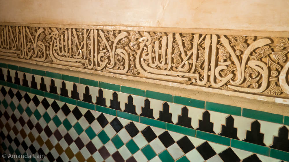 A close up of the details of one of the walls in the Alhambra Palace.