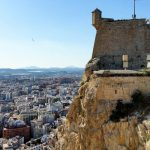 The Santa Barbara Fortress perched on top of a cliff, overlooking the city of Alicante.