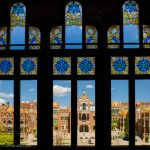 Looking through stained glass windows to the buildings of Sant Pau Hospital in Barcelona.