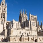 A pilgrim stops outside Burgos Cathedral along the Camino pilgrimage to Santiago de Compostela.