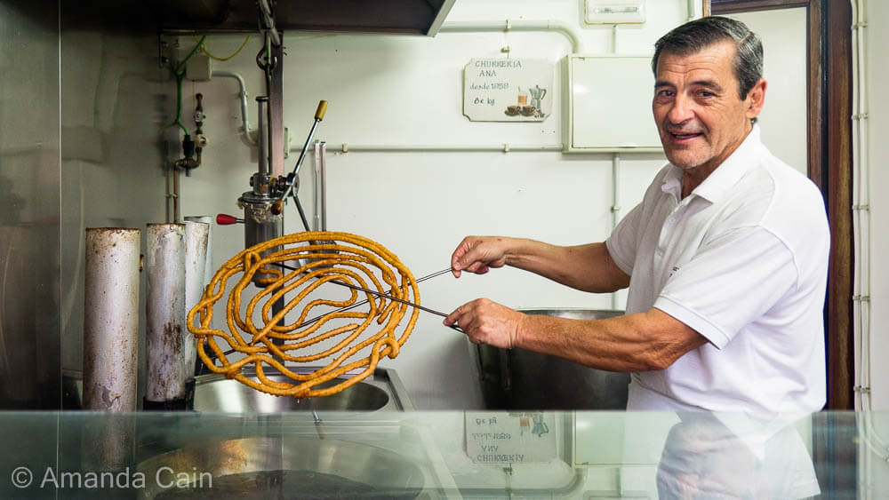 The Churro Master of Cádiz. Everyday he spends the whole morning making nothing but churros.