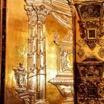 Ornate gold and silver doors guarding the relics of many Catholic saints in the church of San Juan de Dios. Granada.