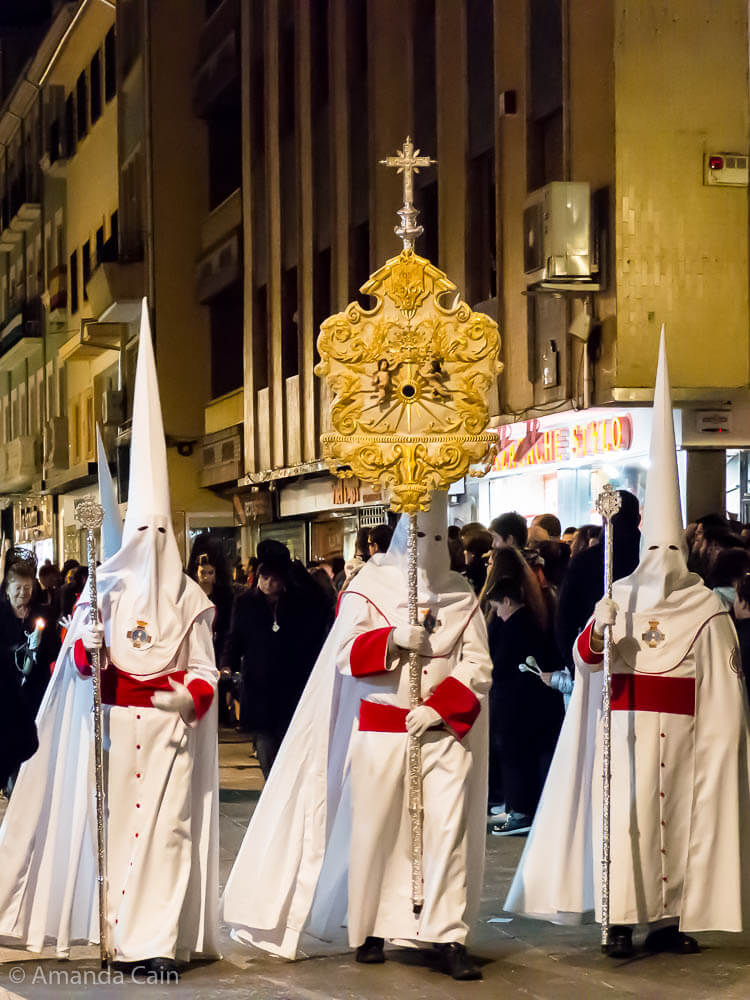 Penitents marching in the Semana Santa procession in Granada.