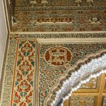 A close up of the intricately carved walls and ceilings in Seville's Alcázar.
