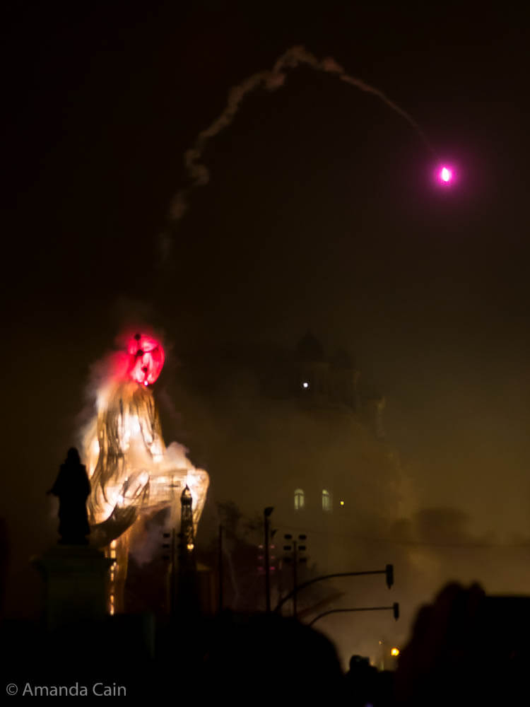 As this sculpture begins to burn, a pink flare is launched from its head.