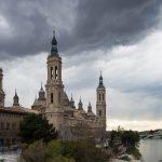 Zaragoza's Basilica Pilar under stormy skies.