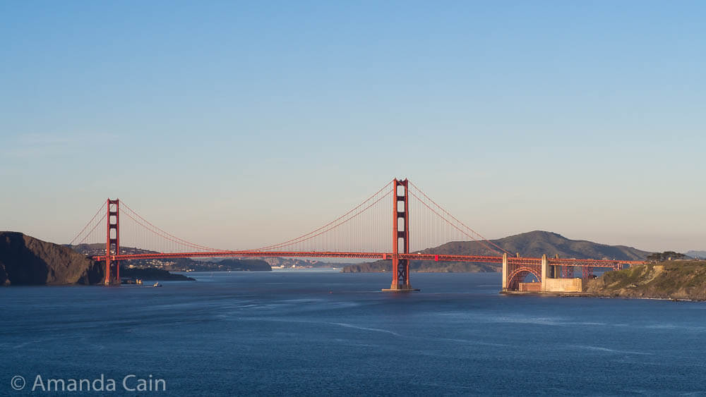 A picture of the view of the Golden Gate Bridge taken from a distance.