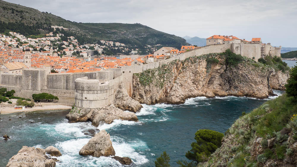 The Old Town of Dubrovnik rising above a stormy sea.