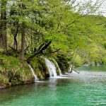 The stunning turquoise water and green foliage of Plitvička Lakes.