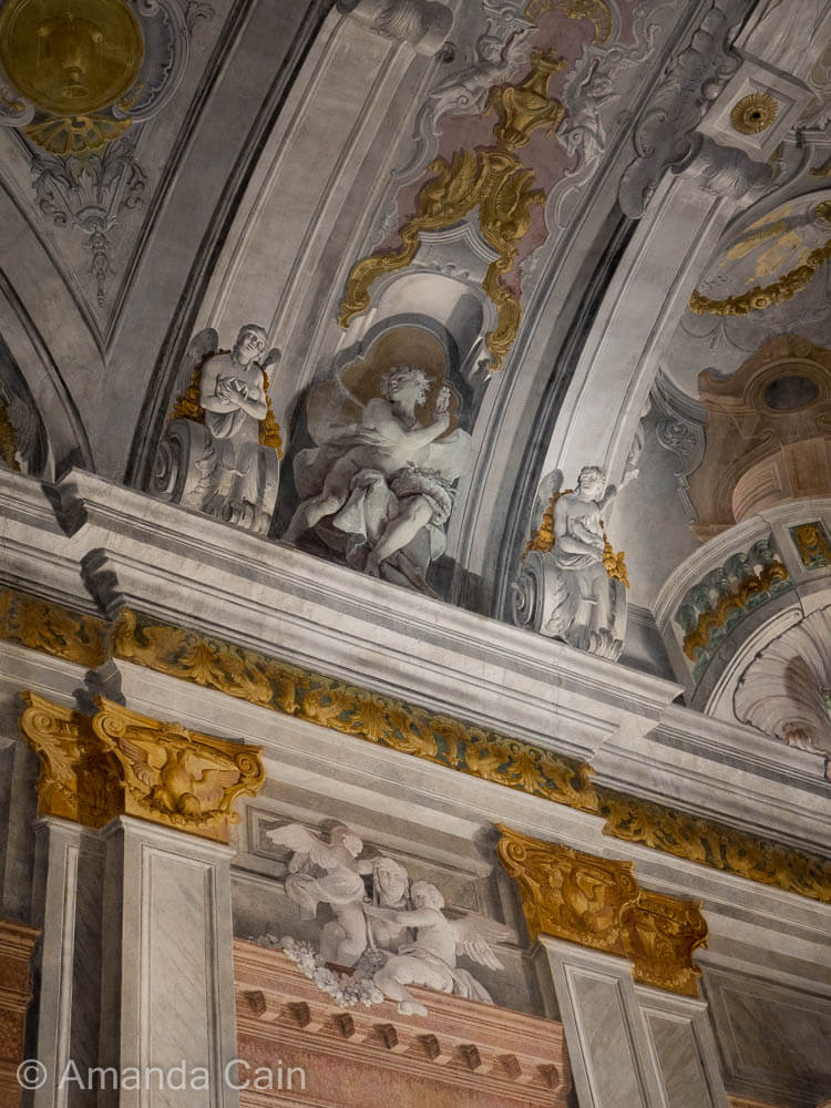 "The Italians were masters of trompe l'oeil; making a flat surface look three-dimensional. Almost all the ""architecture"" here is actually painted onto a flat surface."