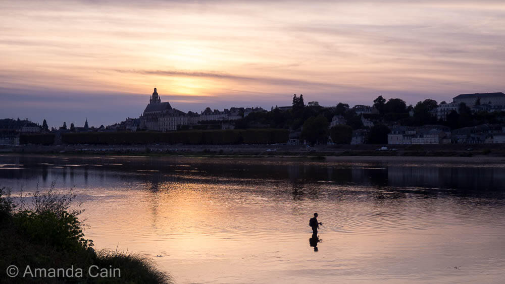 Fishing on the Loire River at sunset.