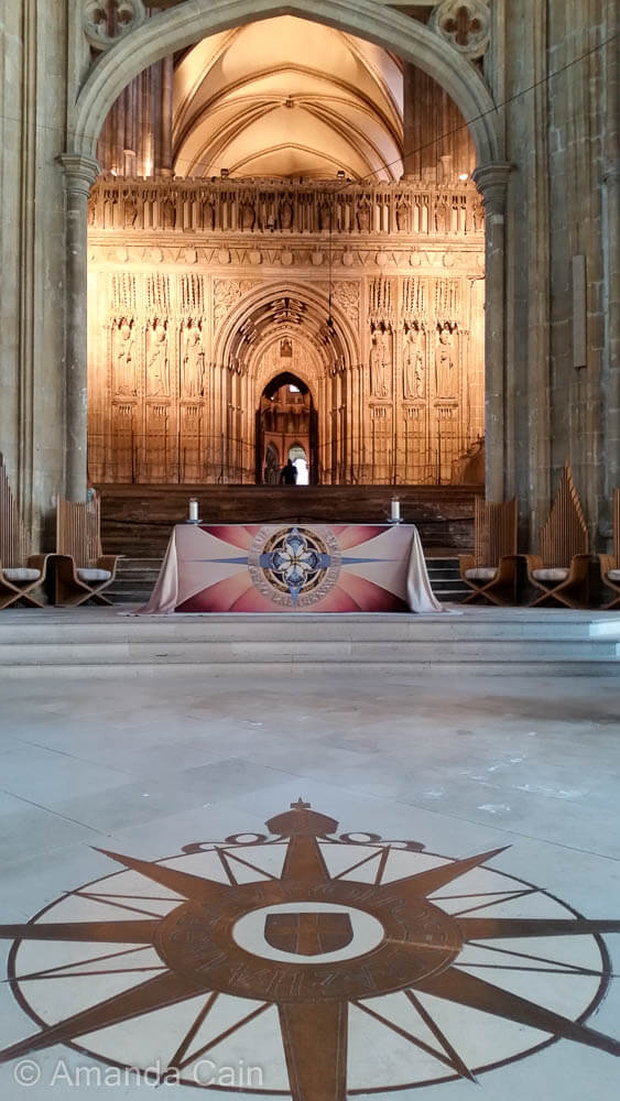 The inside of Canterbury Cathedral, the Mother Church of Anglican Christianity. The compass points to the high altar (not north) to show the importance of this place to Anglicans.