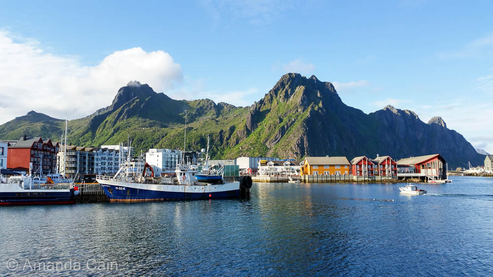 Svolvaer is a town of brightly coloured houses nestled at the bottom of some impressive mountains.