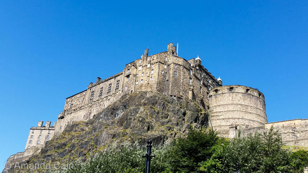 Edinburgh Castle perched on top of a steep crag.