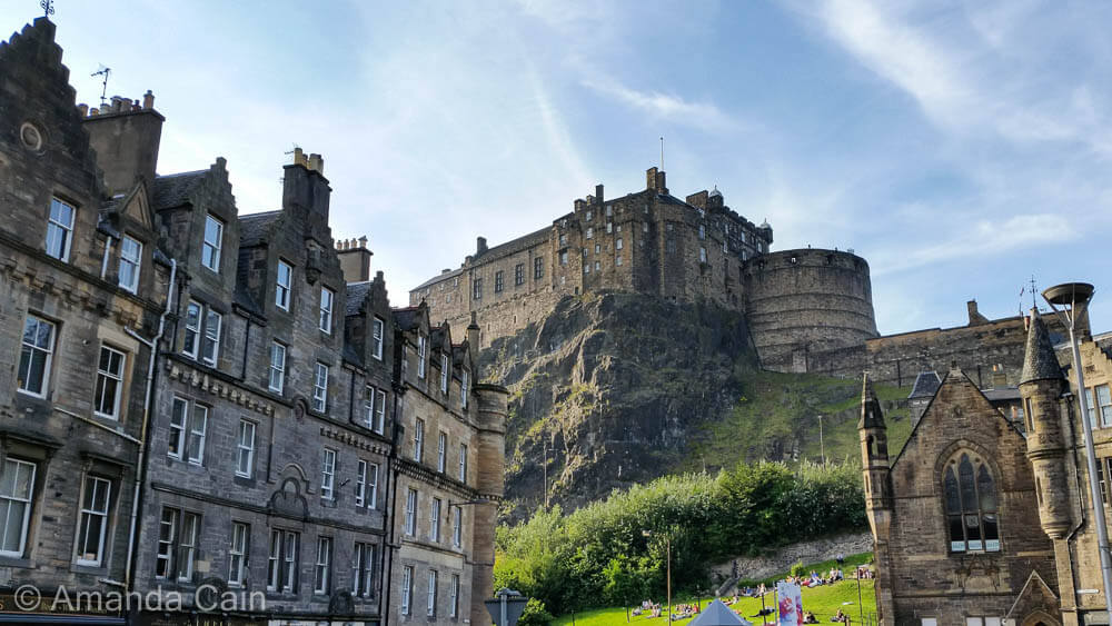 Edinburgh Castle towering over the buildings of the Grassmarket.