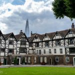 Old and new London, the medieval residences of the Tower of London in the foreground with the Shard rising up in the background.