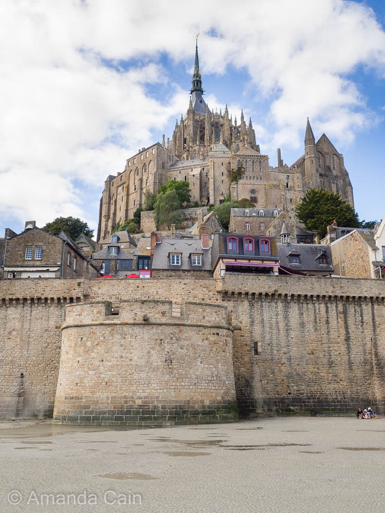 The fortified monastery of Mont Saint-Michel. At low tide it's possible to walk around the outside of the fortifications.