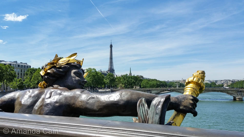 A view over the Seine River from the Pont Alexandre III.
