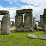 The standing stones of Stonehenge, set up so that they are aligned with the position of the sun during the solstices.