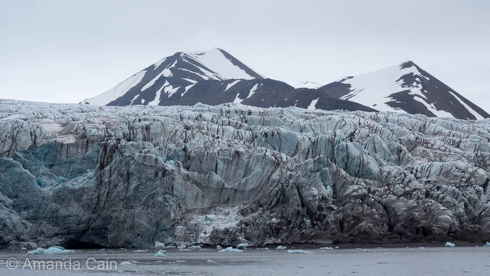 Svalbard's Esmark Glacier is full of streaks of dirt that have been carried along by the ice for thousands of years.