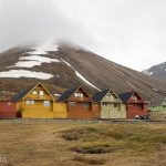 The town of Longyearbyen is full of colourful houses. They are one of the few sources of colour in the high Arctic, a land of white snow and black rocks.