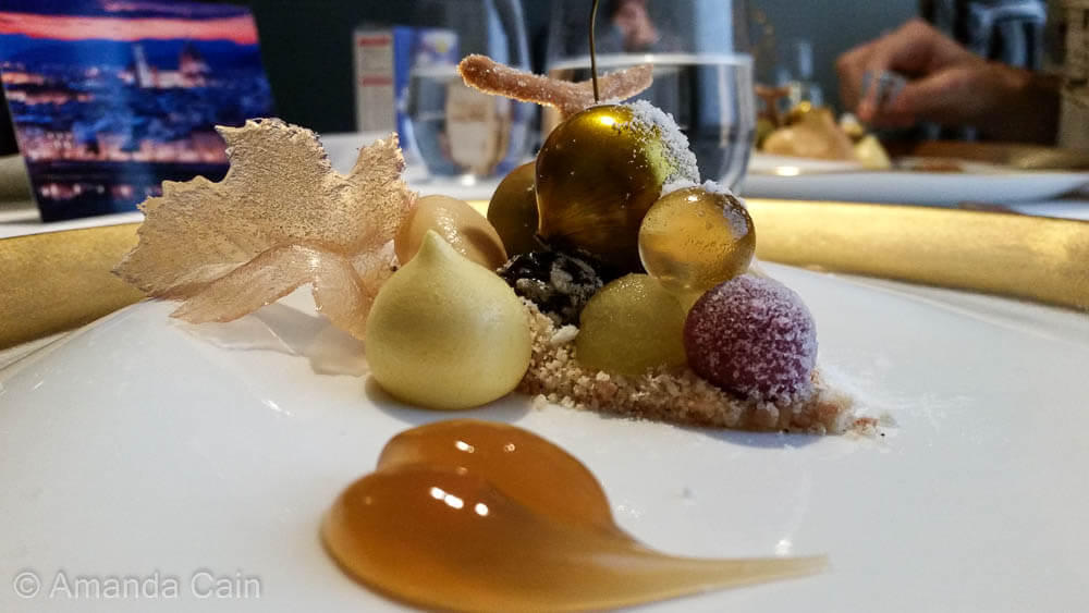 One of several desserts to enjoy during a meal at the Fat Duck. This one combines all the flavour elements of dessert wine in separate spheres.