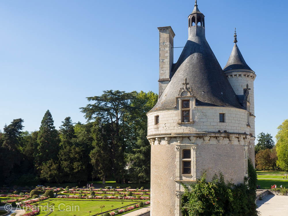 A tower of Chenonceau Chateau looking out over the carefully manicured gardens.
