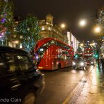Christmas lights, London cabs and double decker buses on Oxford Street.