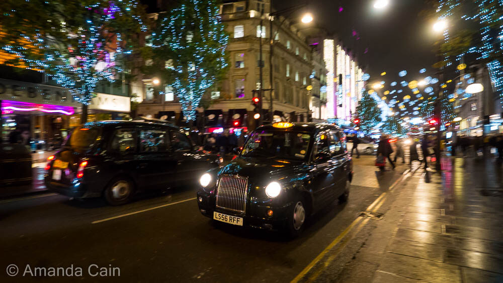 Christmas lights and London cabs on Oxford Street.