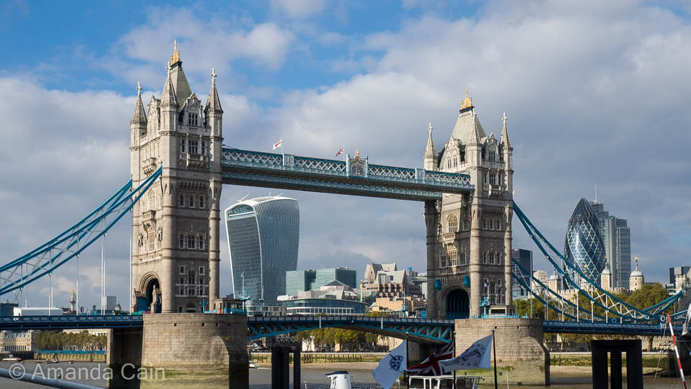 The old Tower Bridge and the modern London skyline behind.