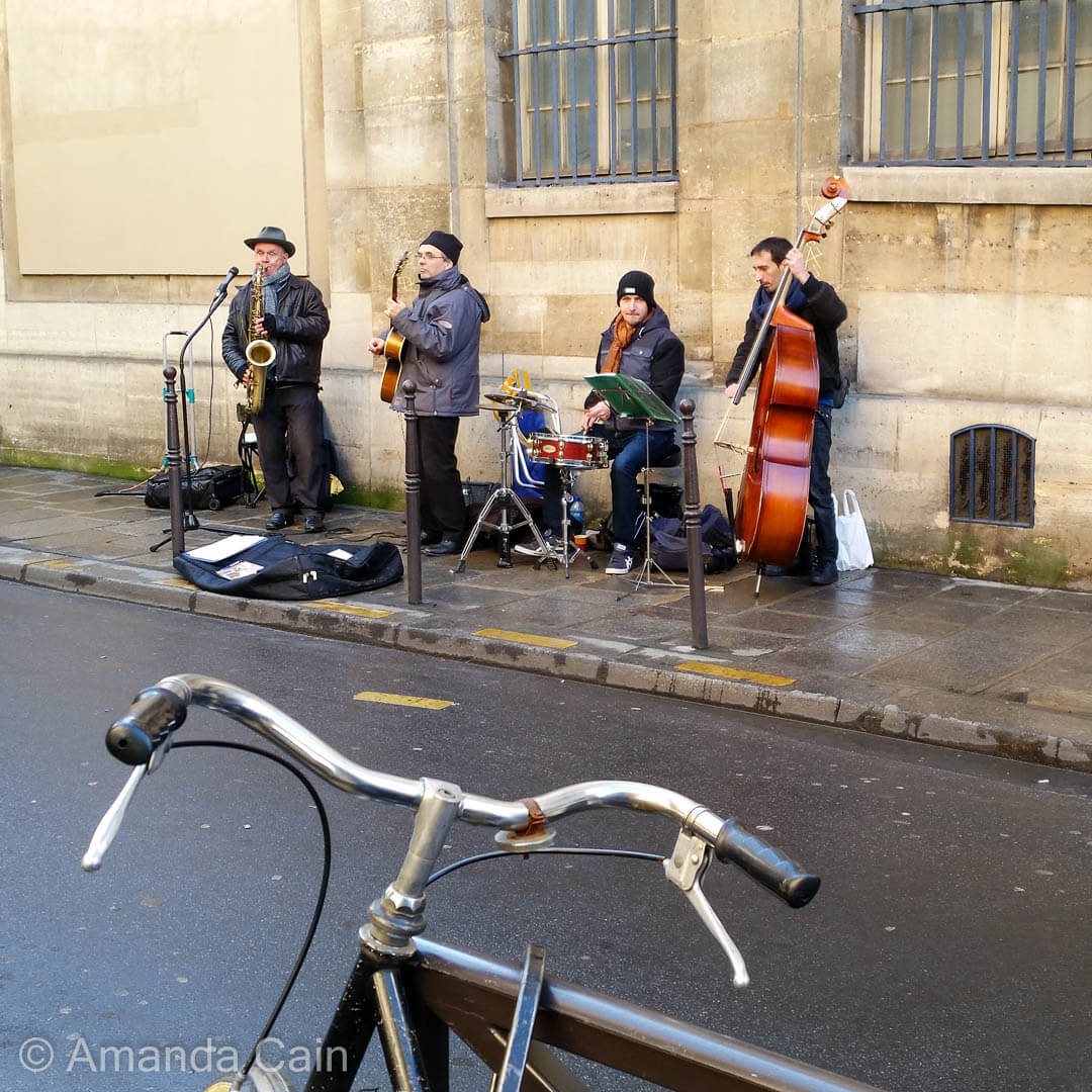 On Sundays the streets of Paris are filled with musicians playing and people enjoying a relaxed stroll along the car-free streets.