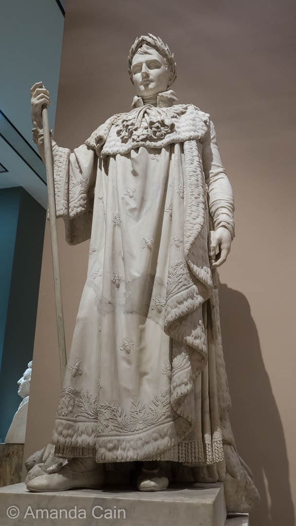 Marble statue of Napoleon in his coronation robes, in the Louvre Museum.