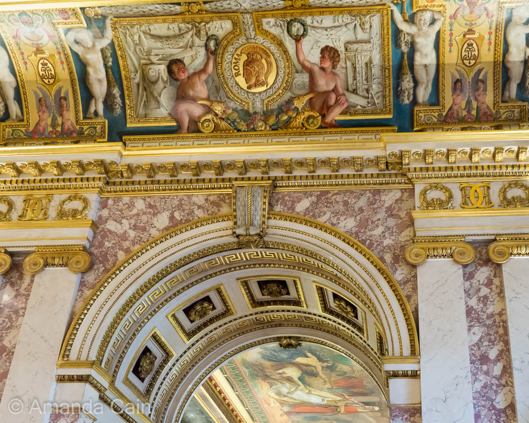 Decorations in an Ancient Rome themed room of the Louvre Museum.