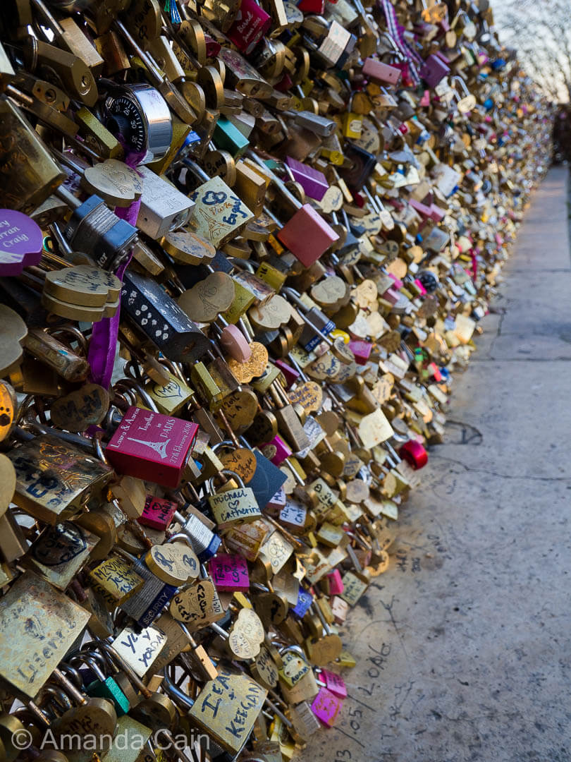 Love locks completely covering the Pont Neuf in Paris.