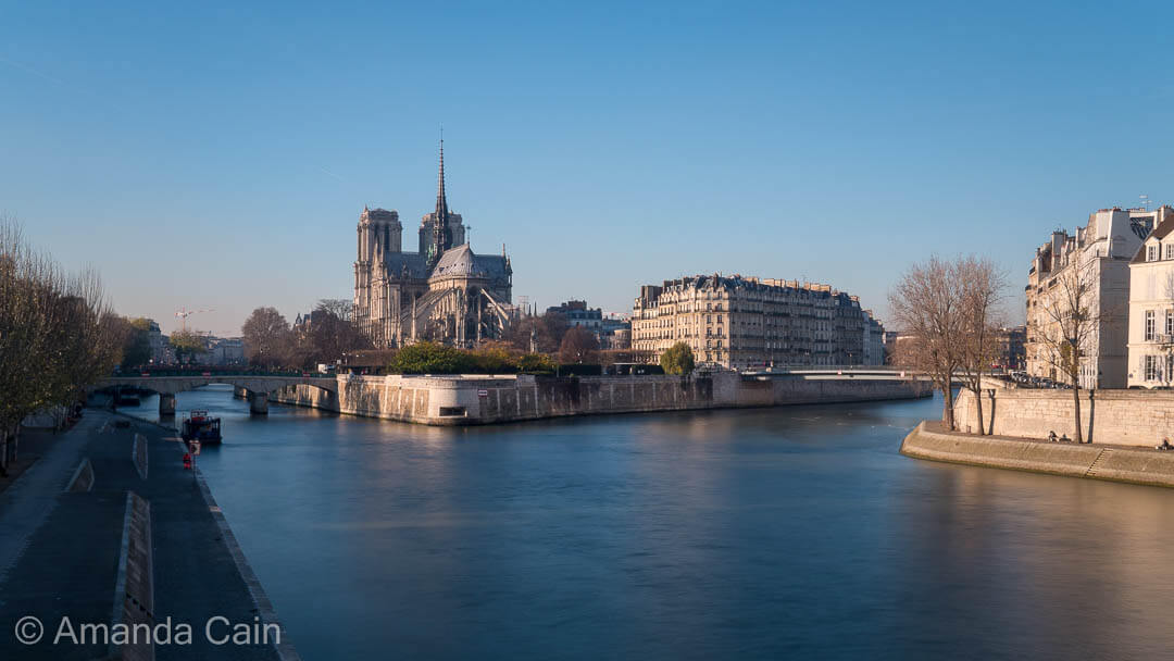 Notre Dame Cathedral on the banks of the Seine River in Paris.