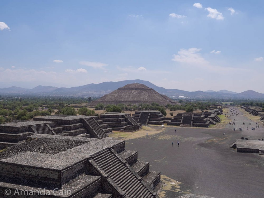 Small pyramids surround Teotihuacan's Plaza of the Moon, with the Pyramid of the Sun in the background.