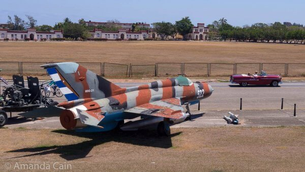 Cuba's old military hardware on proud display. The MiG jet is probably as old as the classic car in front of it.