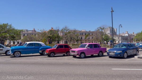 Ways to get around in Havana: Audi, Lada, Fiat & classic American car. And if you look close on the far left you can make out a horse and carriage.