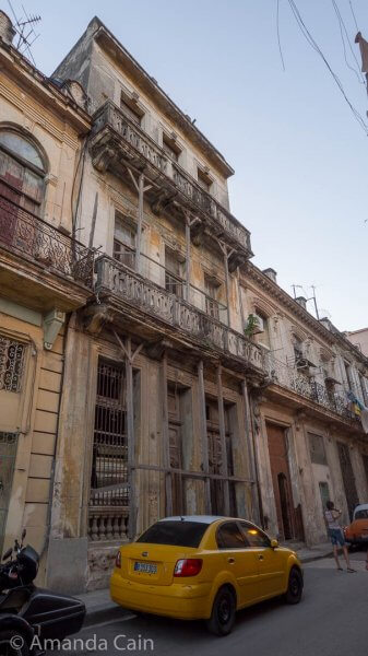 Here's one of the many crumbling grand buildings of Havana, with the balconies held up with bits of wood.