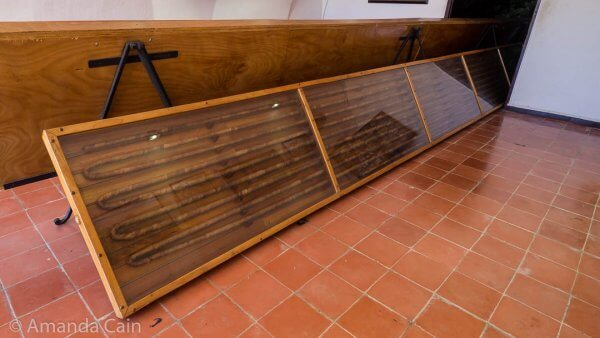 Here is the world's longest cigar: measuring 81.80m long. Only half of it fits in the room, the other half is in the room behind.