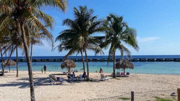 The beach of Playa Giron with a lovely view of a seawall...