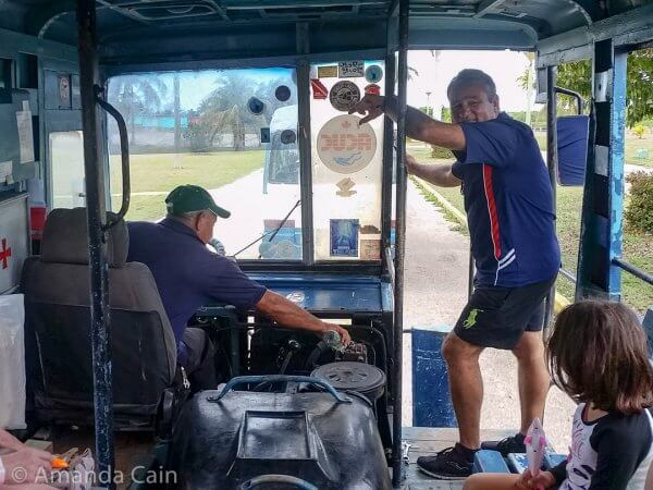 """Ol' Clanky getting a tow start from a passing minibus. I'm not sure what the driver is pouring over the engine here, but I wouldn't be surprised if he's following the Cuban tradition of pouring out a little rum """"for the saints"""" for good luck."""
