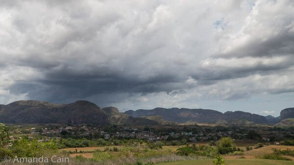 Storm clouds gather over the town of Viñales.