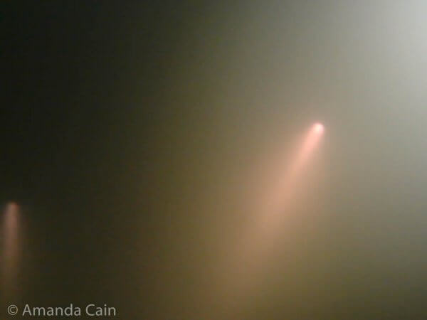 Inside the hydrogen sulfide fog, all you can see is the pinkish-brown glow from the torches.