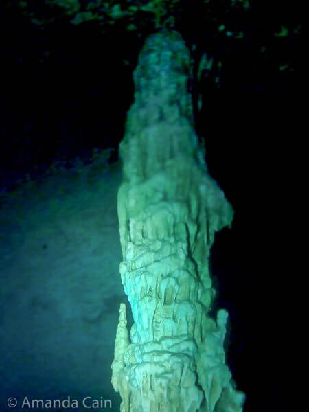 "One of the ""giant melted candle"" limestone formations in the Bat Cave in Cenote Dos Ojos."
