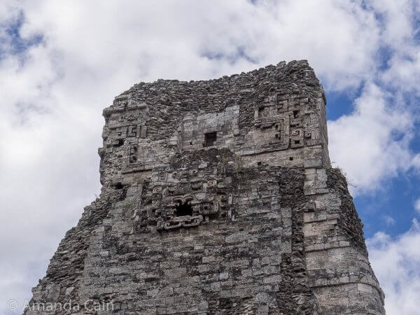 The back side of the central tower of Xpujil. You can see a jaguar face sticking out from the centre of it.