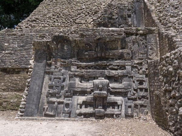 "One of the ""masks"" on the side of a pyramid in Caracol."
