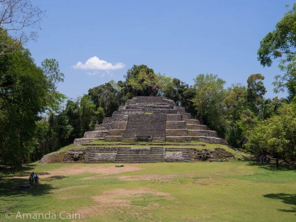 "The Jaguar Temple of Lamanai. It gets its name from the two jaguar ""masks"" on either side at the bottom of the pyramid."