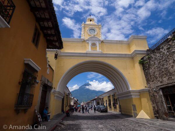 The Arch of Santa Catalina with Volcan Agua (Water Volcano) in the background.